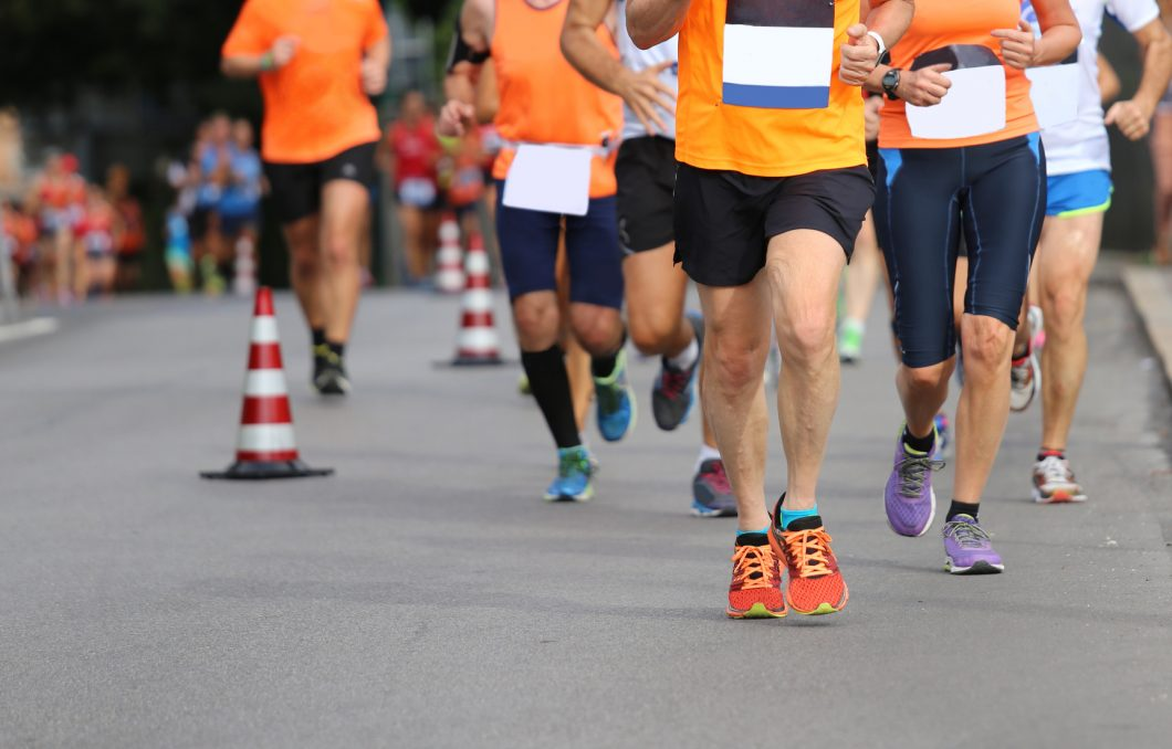 athletes run the marathon on the city road without logos